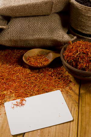 Spice saffron and bags on the wooden table Standard-Bild