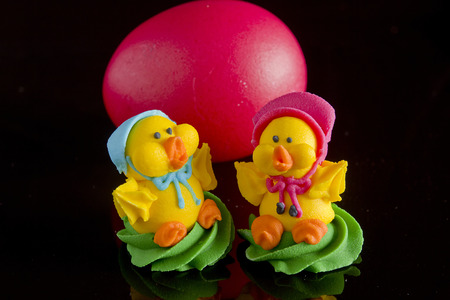 Easter egg and decoration for the cake on a black background