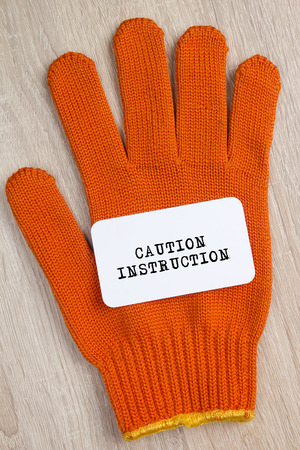 protective: Construction protective glove and a card with the words Safety