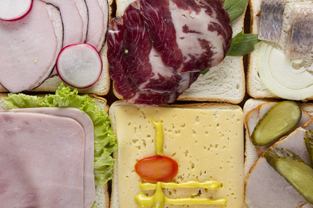 Still life of sandwiches on a wooden background