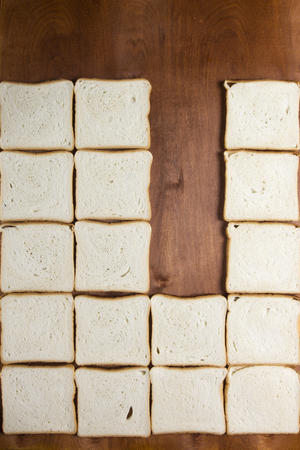 Homemade white bread for sandwiches on a wooden background