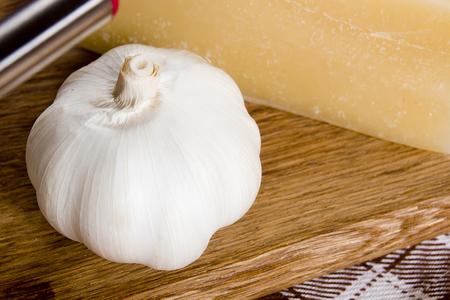 gruyere: Garlic and cheese Gruyere fondue set on a cutting board