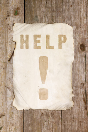 mail me: Help Ads on old paper on a wooden surface