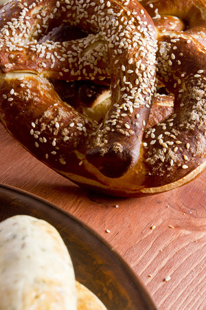 Typical German pretzel for a beer on a wooden table Stok Fotoğraf - 57991247