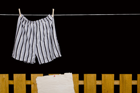 dry suit: Mens underwear hanging on a clothesline over the fence