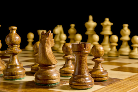White and black chess pieces on a chessboard Stock Photo - 59059314
