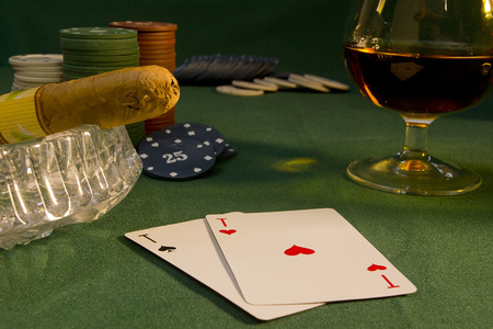 Poker concept with chips and cards on the green table cigar