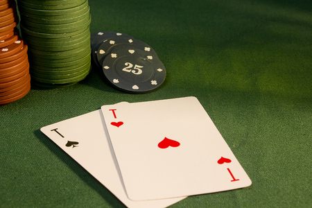 green background: Cards with poker hand with chips on a green background