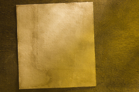 dirty sheet: Dirty old sheet of paper on dark wooden background
