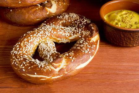 German salty pretzel on a wooden background