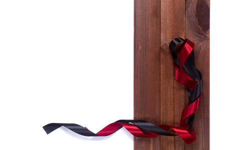 black satin: Black and red satin ribbon on the wooden background