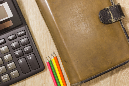 docket: Planner with calculator and pencils on the table