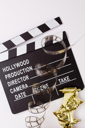 party poppers: Theatrical masks, party poppers and film for cinema on a white background