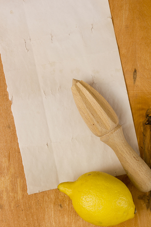 squeezer: lemon and squeezer on a wooden background Stock Photo