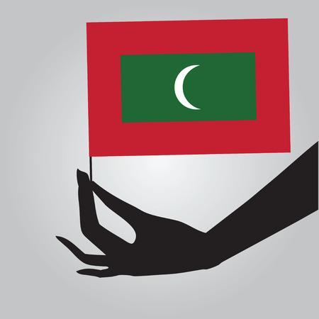 여성 손에 몰디브의 국기