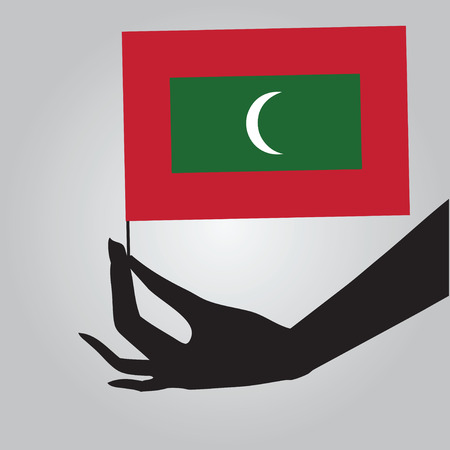 Flag of Maldives in a female hand