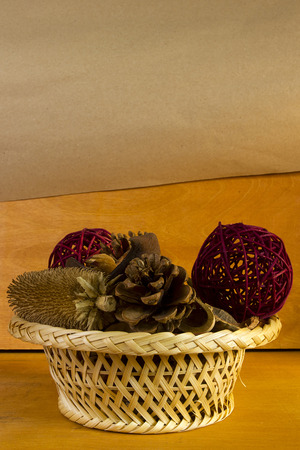 potpourri: Colorful assorted potpourri in a wicker basket on a wooden table