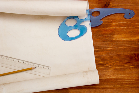 Roll of paper for drawings on a wooden table