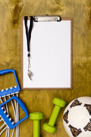 sports coach: Items for the sports coach on a wooden surface Stock Photo
