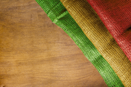 Flag State of Bolivia on a wooden surface.
