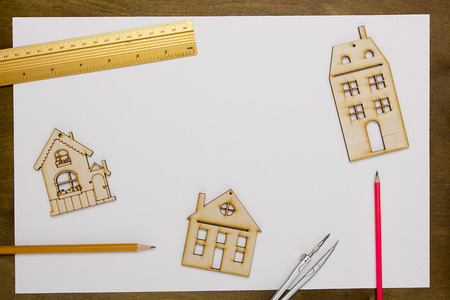 resale: Model home on a white sheet of paper on a wooden table Stock Photo