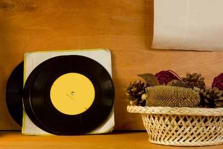 vinyl records: Basket with potpourri and vinyl records on a wooden background