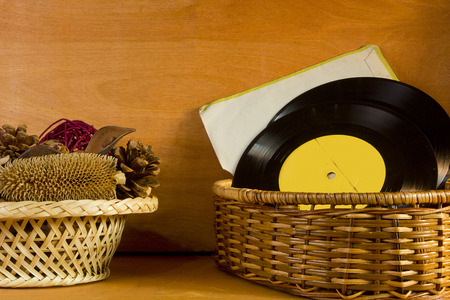potpourri: Basket with potpourri and vinyl records on a wooden background