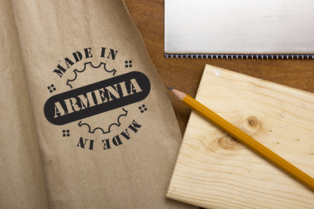 Industrial poster Made in Armenia, the stamp imprint on paper.