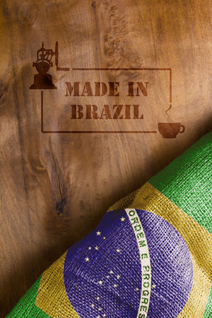 predominant: The predominant industry in Brazil - coffee. Flag of Brazil and hot stamp on wood Made in Brazil with a cup of coffee.