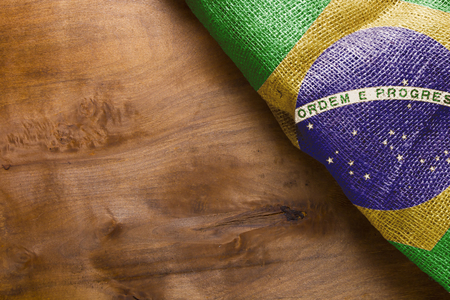 sacking: Flag State Brazil, from a sacking on a wooden background.