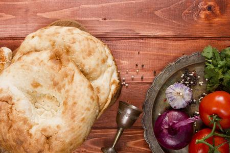 uzbek: Traditional uzbek flatbread and a set of spices Stock Photo