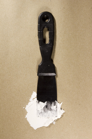 putty knives: Putty Knife with Spackling Paste to Repair Wall Damage
