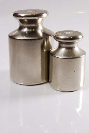 Set of precision weights for scales on a gray background Stock fotó