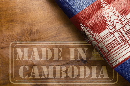 The national flag of the State of Cambodia and marking on a wooden surface Made in Cambodia.