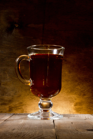 Glass of mulled wine on a wooden background Stock Photo