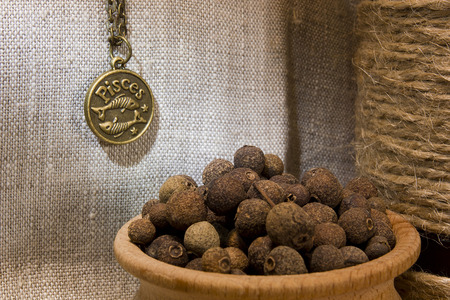 allspice: Allspice in a wooden bowl on burlap background