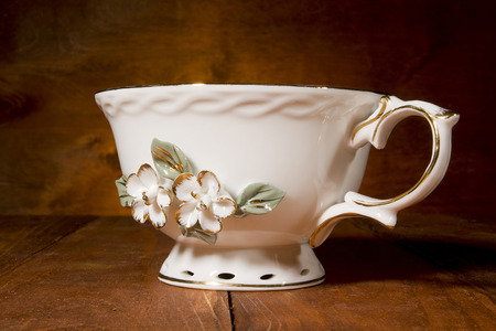 Antique teacup on a dark wooden background Stock Photo