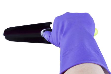 empleadas domesticas: Hand in glove with garden tool on white background Foto de archivo