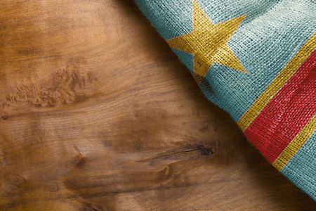State of the Congo flag on a wooden background.