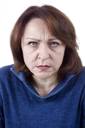 choleric: Senior woman with an angry expression on his face on a white background