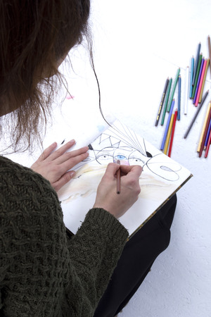 finders: Young girl artist drawing pencils on white background