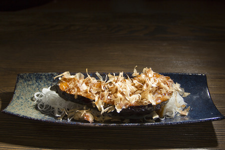 Purple eggplant Japanese food on a wooden table Imagens