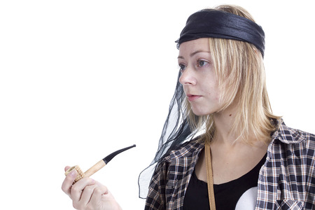Young woman in the image of a pirate on a white background