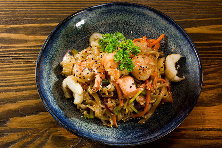 dish of Japanese cuisine seafood, buckwheat noodles and vegetables