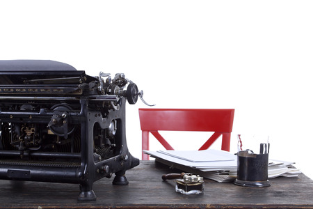 copies: Antique typewriter on a vintage table with an old wooden surface