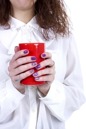 Orange ceramic cup of coffee in female hands