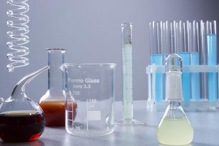 analyses: Multicolored liquids in laboratory glassware on a gray background