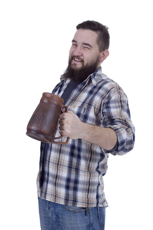 Happy bearded man with a clay beer mug