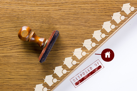 Wooden stamp for documents. Real estate activities. Stock Photo