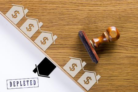 bureaucrat: Wooden stamp for documents. Real estate activities. Stock Photo